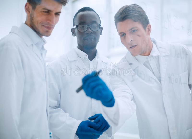 Promising scientist makes notes on the Board. Concept of education royalty free stock photos