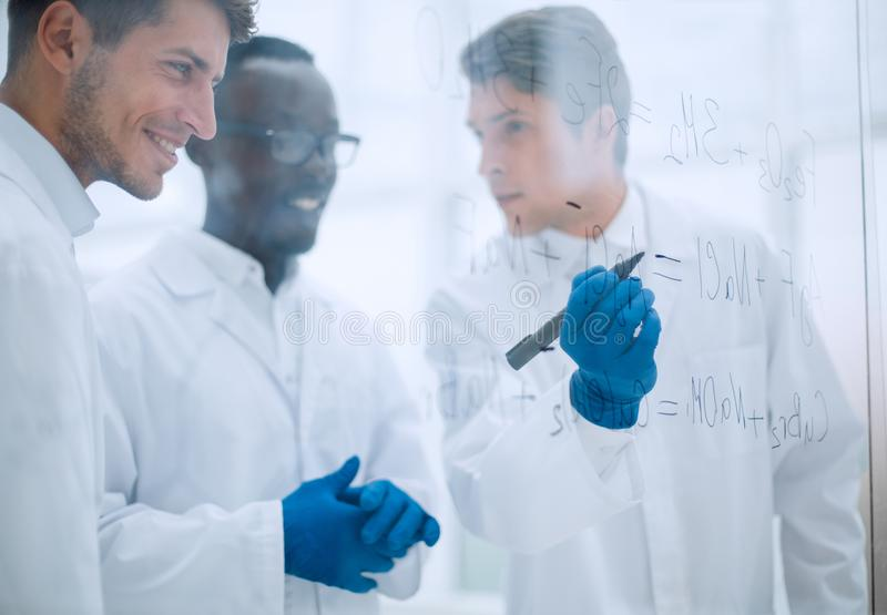 Promising scientist makes notes on the Board. Concept of education stock photos