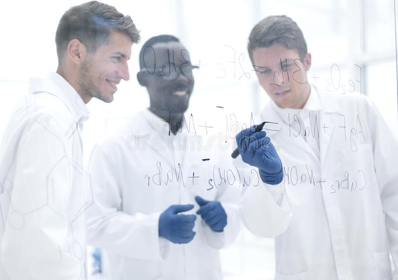 Promising scientist makes notes on the Board. Concept of education stock images