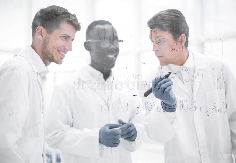 Promising scientist makes notes on the Board. Concept of education royalty free stock images
