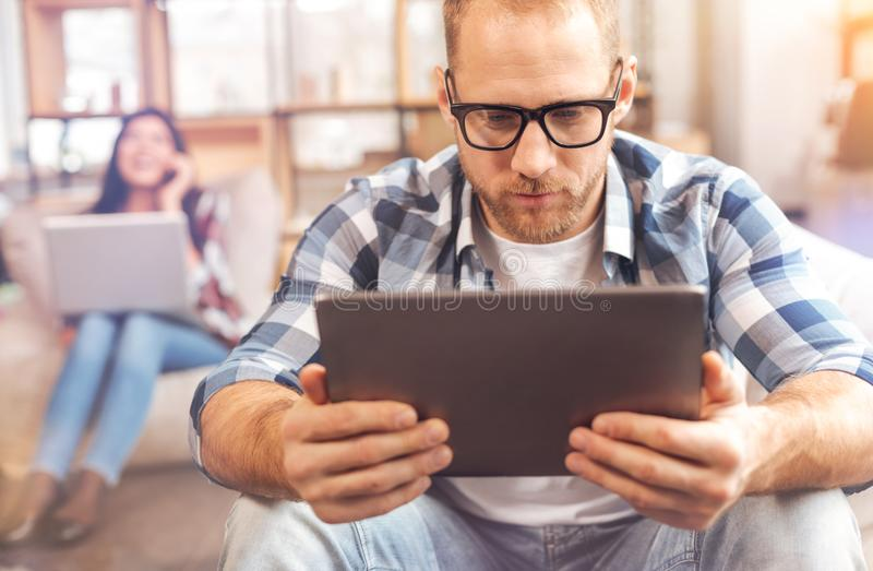 Handsome male freelancer working with tablet computer stock photos