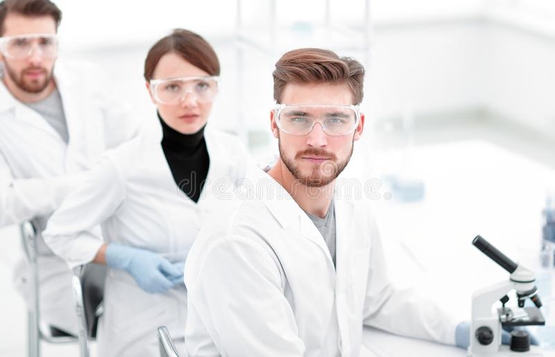 Promising young scientists in the laboratory. Photo with copy space royalty free stock image