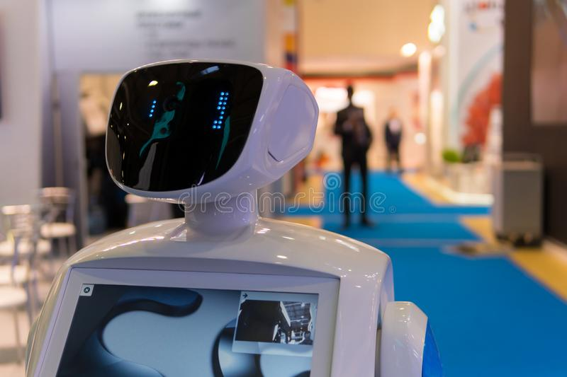 Promo robot to work at exhibitions. Robot guide. Modern technologies in advertising, promotion and presentation. Promo robot to work at exhibitions. The robot royalty free stock images