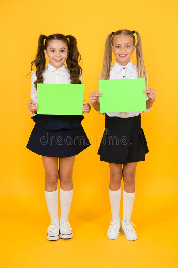 Promotion and marketing. Happy children holding empty show cards. Little children smiling with green paper sheets. Small royalty free stock photo