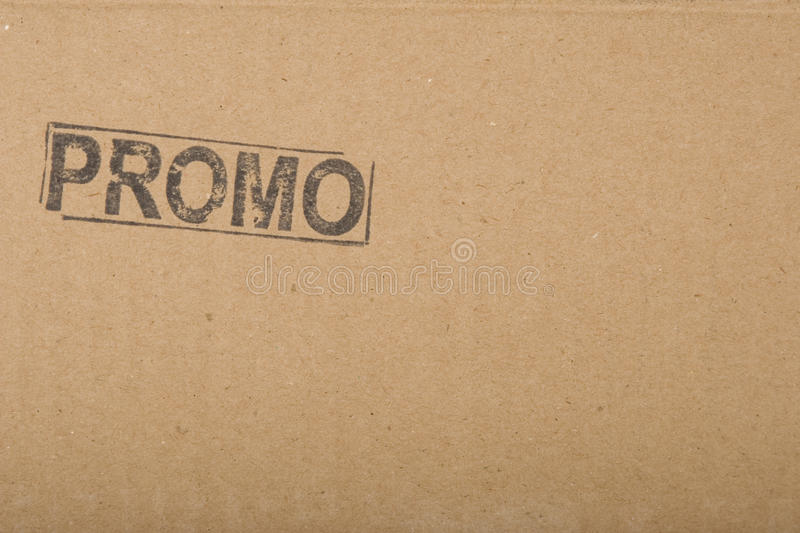 Promotion message copy-space on cardboard texture royalty free stock photography