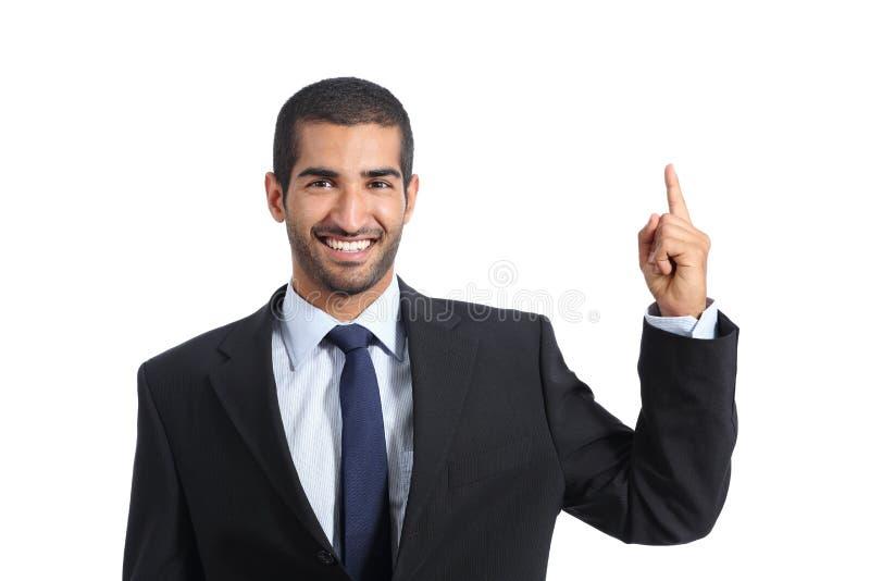 Promotor árabe do homem de negócio que introduz e que aponta um produto vazio fotografia de stock