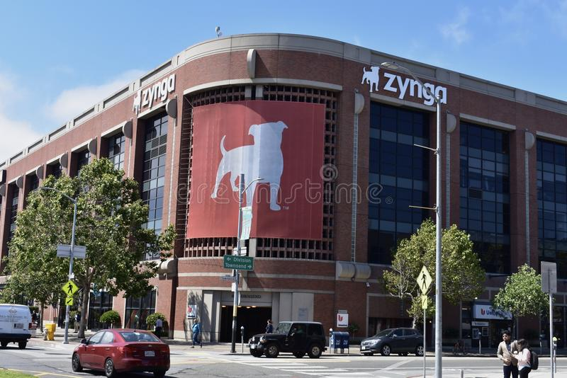 Promotor Zynga del juego y el dogo americano fotos de archivo