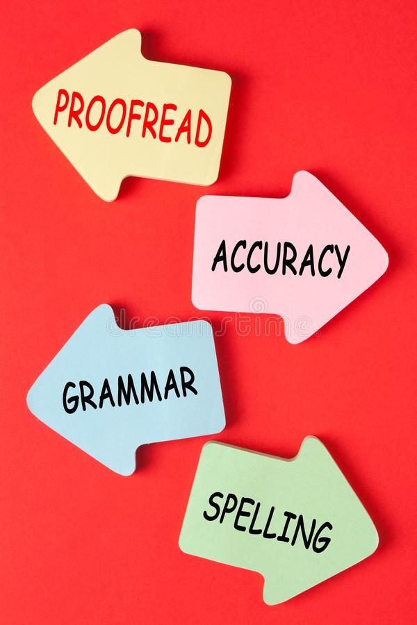 Proofreading Grammar Spelling Accuracy. On paper arrows royalty free stock photography