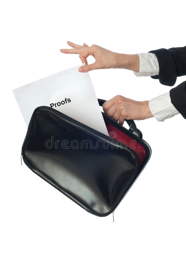 Proofs. Investigator examines in details the materials of proofs reported by advocate stock photos