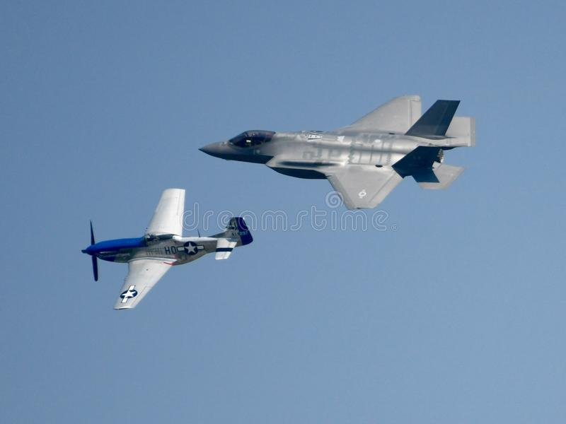 A Prop and a Jet. This is a Summer picture of two airplanes performing over Lake Michigan in the 2018 Chicago Air & Water Show located in Chicago, Illinois in stock photo