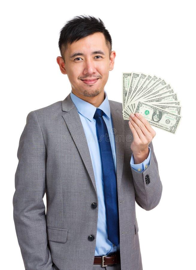 Propagação da terra arrendada do homem de negócios do dinheiro fotos de stock royalty free
