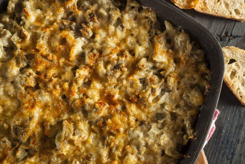 Propagação de queijo caseiro da alcachofra do alho imagens de stock royalty free