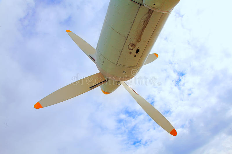 Propeller aircraft against the sky. Lovely view of the vast and powerful motor against the blue sky royalty free stock image