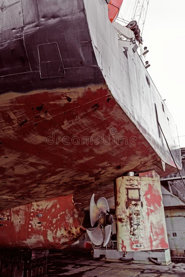 Propeller of cargo ship. Dry dock. View from stern. Rusty. Before repeating work royalty free stock photography