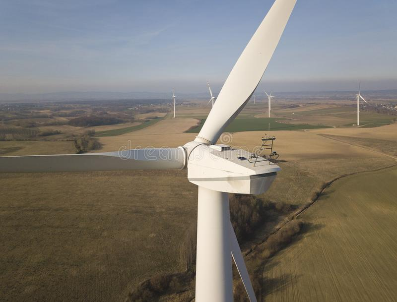 Propeller wind power near. Rotating blades of energy generators. Environmentally friendly electricity. Modern technologies for the royalty free stock photography