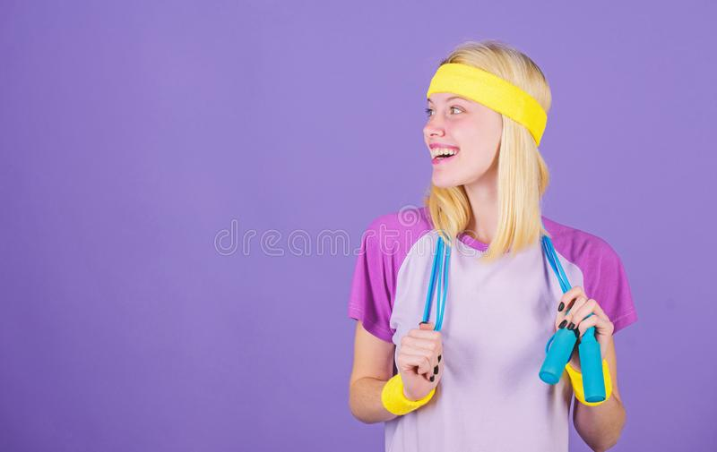 Proper approach to lose weight. Weight loss concept. Jumping rope is great calorie burner. Girl hold jumping rope wear. Bright wristbands. Woman exercising with stock photography