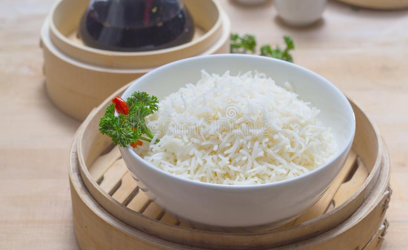 Proper cooked rice. Full cooked rice on a bamboo bowl with leaf for food and beverages presentation stock image