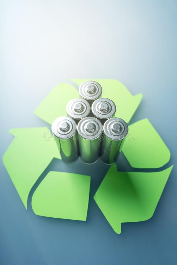 Proper disposal of toxic to the soil environment and batteries. Recycling of harmful substances for ecological. Used AA and proper disposal of toxic to the royalty free stock image