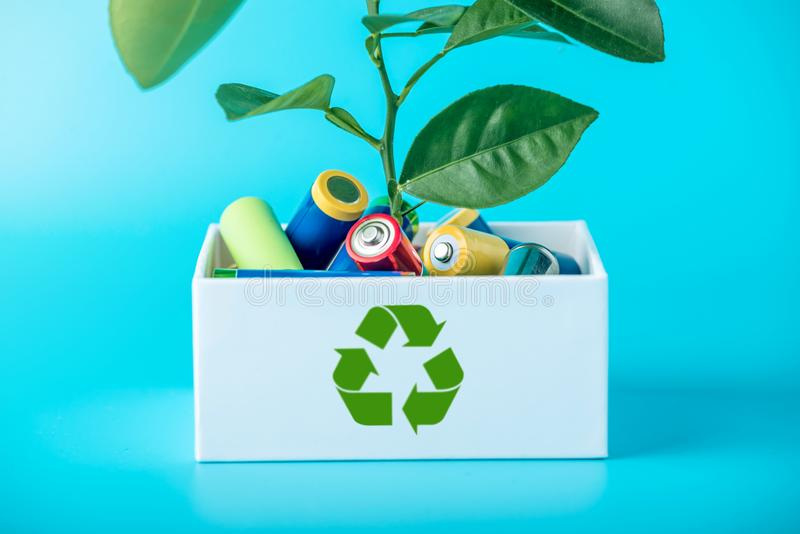 Proper disposal of toxic to the soil environment and batteries. Recycling of harmful substances for ecological. Used AA and proper disposal of toxic to the royalty free stock photo