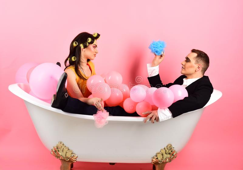 A proper grooming. Couple in love in bath tub. Couple of mime man and woman enjoy bathing. Bubble bath day. Beauty stock photography