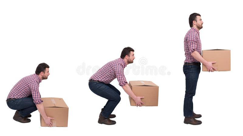 Proper heavy weight boxes lifting against backache royalty free stock photo