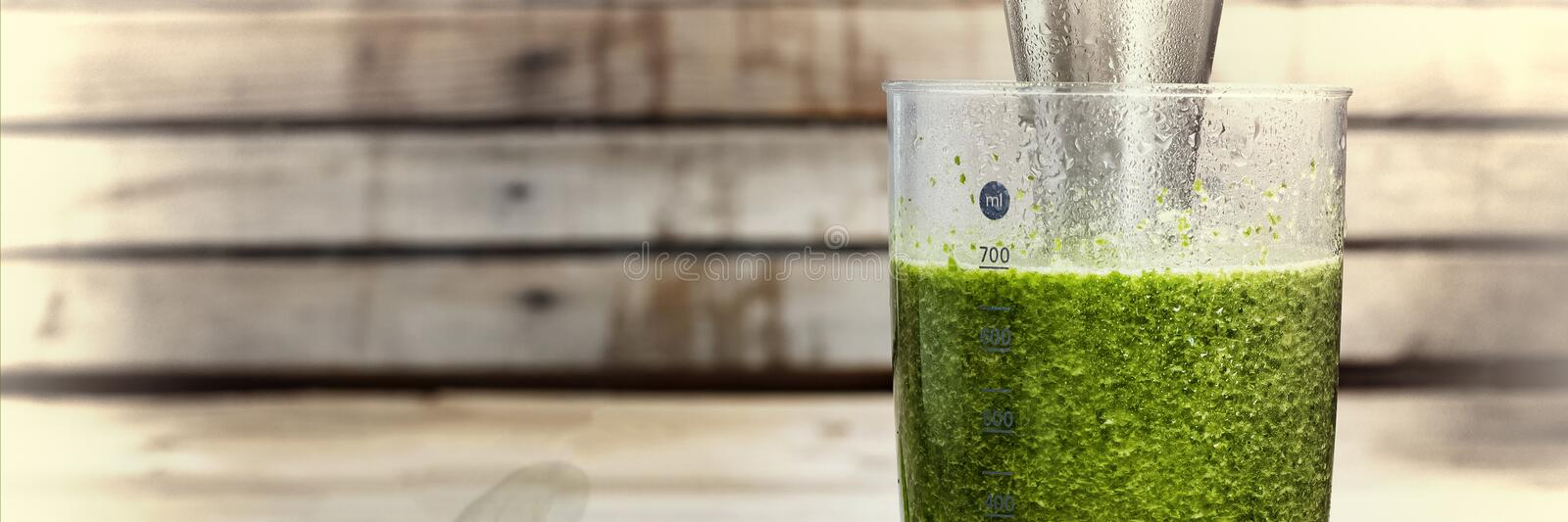Detox drink made from spinach, cucumber, lime and avocado. Proper nutrition. DETOX drink made from green vegetables in a blender. royalty free stock photography