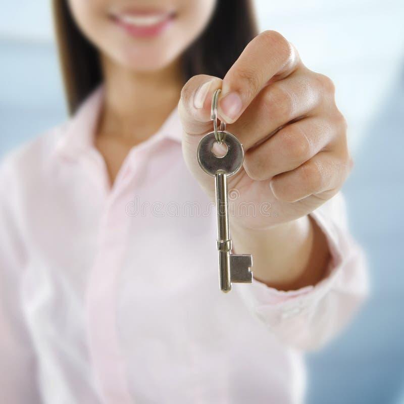 Property Agent. Holding a key stock photography