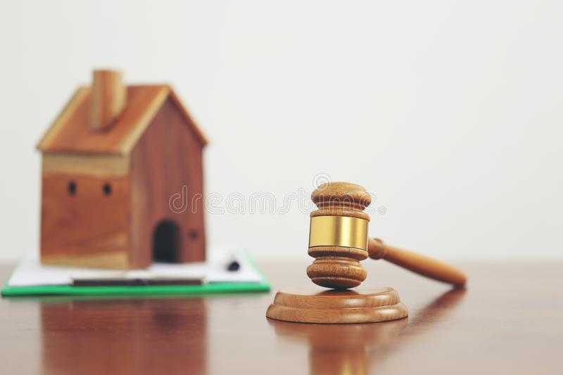 Property auction, Gavel wooden and model house on white background, lawyer of home real estate and ownership property concept.  royalty free stock images