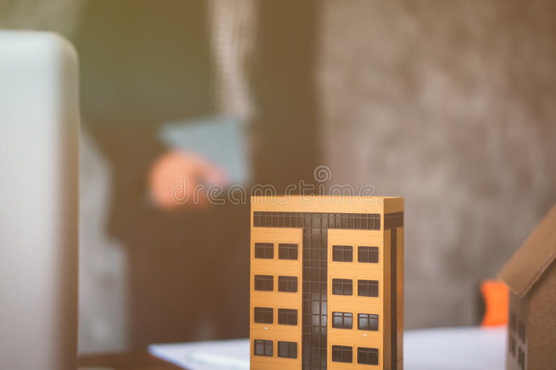 Property business with houses and buildings for sale. Business man buying and selling properties stock images