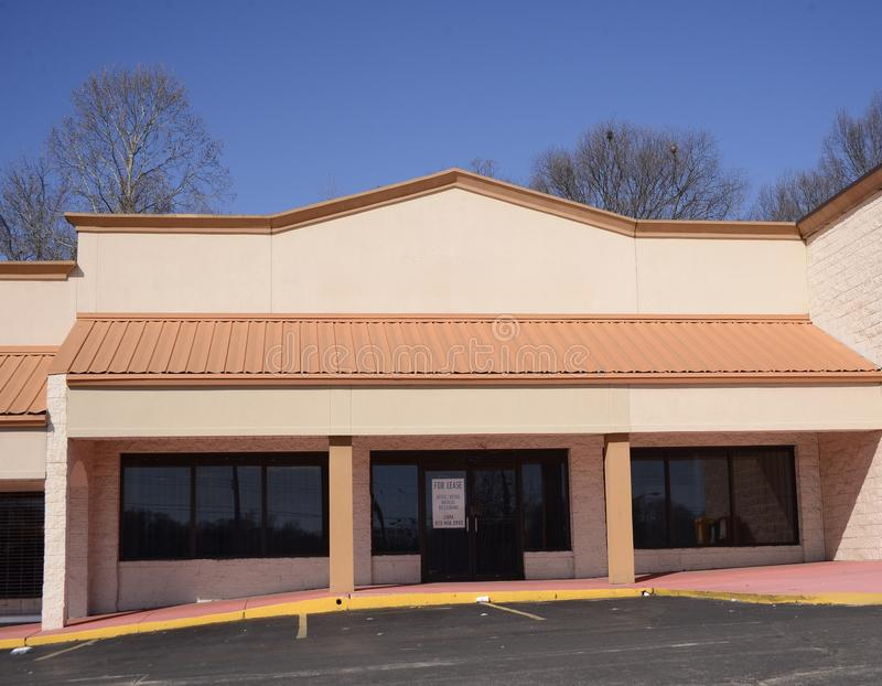 Strip mall Property for Lease. This property in a commercial strip mall that is available for lease to use as office, retail, beauty shop, repair or other royalty free stock image