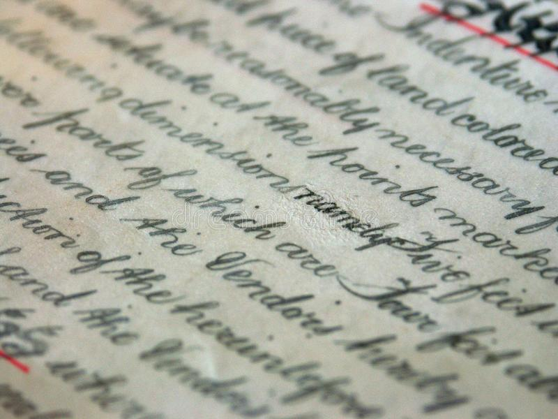 Property deed 05. Close up of handwritten title deed royalty free stock photo