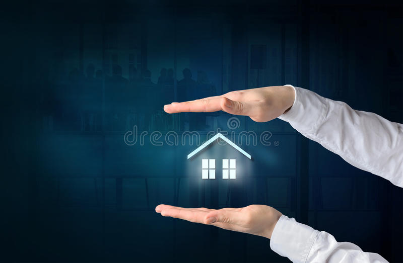 Property insurance concept. Home insurance and security concept. Protecting gesture of businessman and symbol of house and business background royalty free stock image