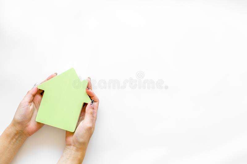 Property insurance concept with house toy in hands on white background top view mockup. New house purchase. Property insurance concept with house toy in hands on royalty free stock image