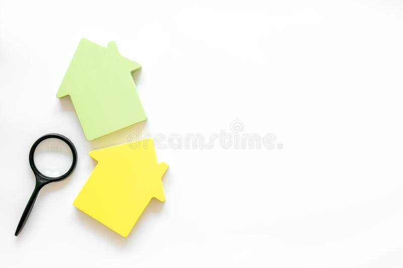 Property insurance concept with house toy and magnifier on white background top view mockup. New house purchase. Property insurance concept with house toy and royalty free stock photography