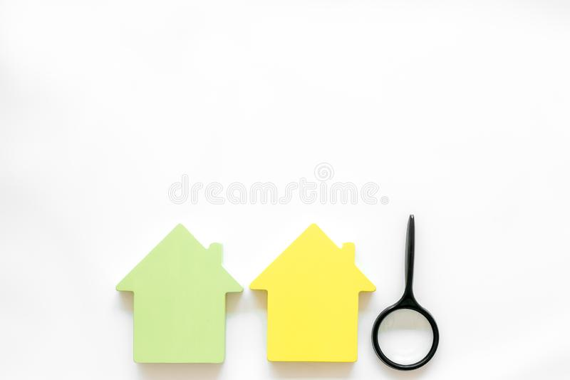 Property insurance concept with house toy and magnifier on white background top view mockup. New house purchase. Property insurance concept with house toy and royalty free stock photos