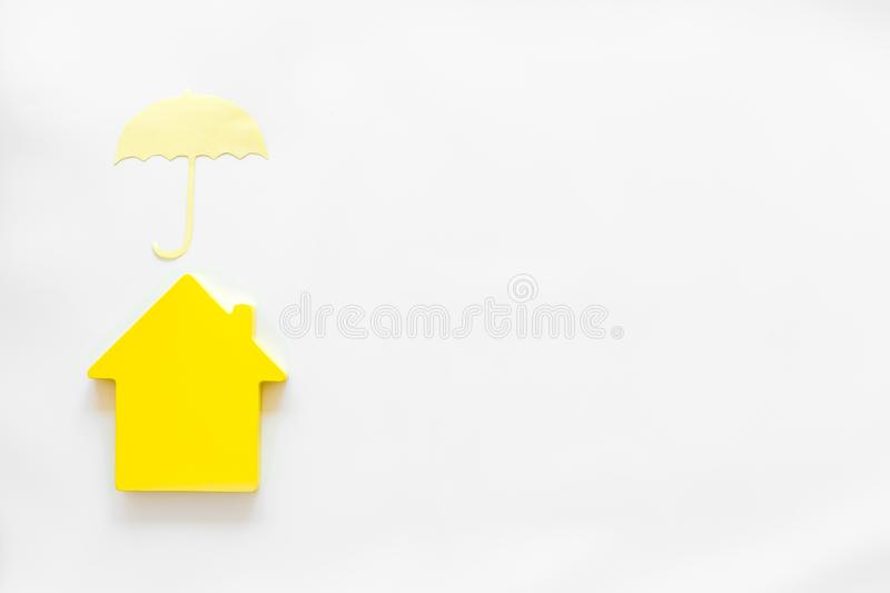 Property insurance concept with house and umbrella toys on white background top view mockup. New house purchase. Property insurance concept with house and stock images