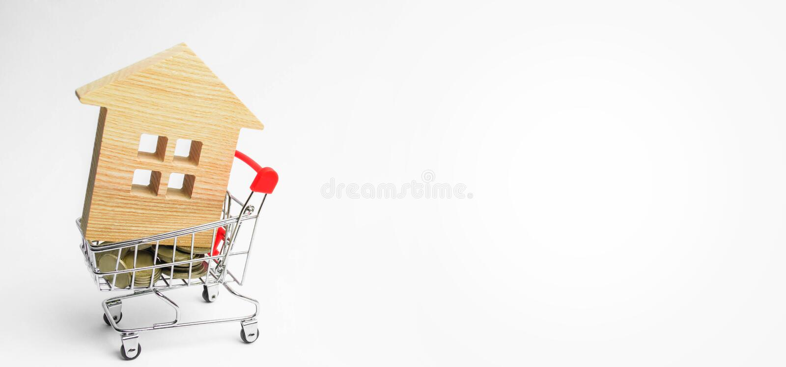 Property investment and house mortgage financial concept. buying, renting and selling apartments. real estate. Wooden house in a S stock images