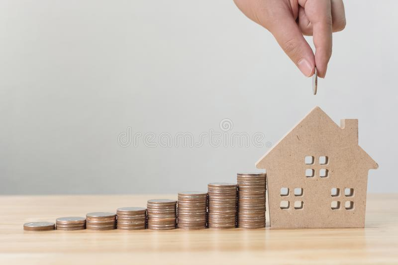 Property investment and house mortgage financial concept, Hand putting money coin stack stock images