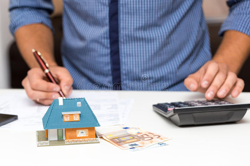 Property management concept, calculating house expenses stock photo