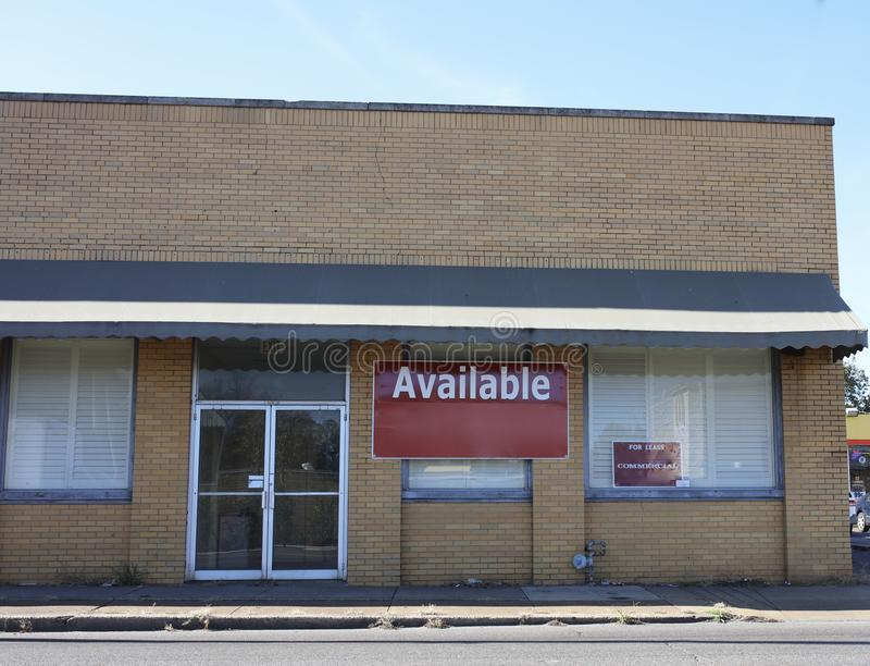 Property for Sale or Lease. A office building in a commercial area that is for sale or lease stock image