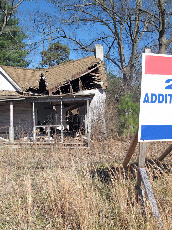 Property For Sale. Rundown abandoned house with land up for sale stock photo