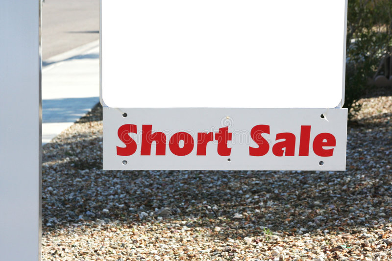 Property short sale sign. Property for sale sign with short sale rider attached stock image