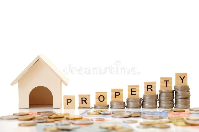 Property text written on block with stacked RM  Ringgit Malaysia  coins and house. On white background royalty free stock images