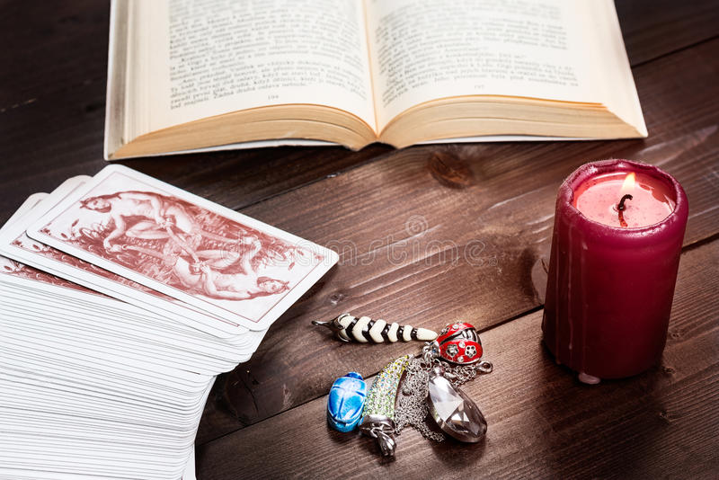 Prophecy Vintage. Composition of esoteric objects,candle,cards and book used for healing and fortune-telling stock image