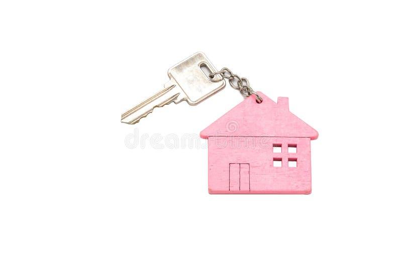 Propiedades inmobiliarias, concepto casero, llave de la casa con aislado en el fondo blanco, espacio de la copia imágenes de archivo libres de regalías
