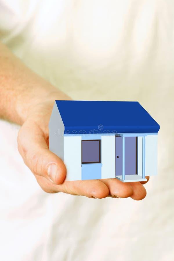 Propiedades inmobiliarias - en la mano imagenes de archivo