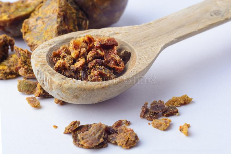 Propolis granules in a wooden spoon. Bee glue. Bee products. Apitherapy. Apiculture. Propolis granules in a wooden spoon. Bee glue. Bee products. Apitherapy royalty free stock photography