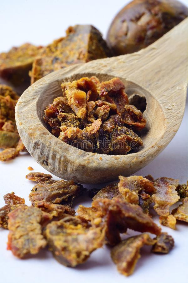 Propolis granules in a wooden spoon. Bee glue. Bee products. Apitherapy. Apiculture. Propolis granules in a wooden spoon. Bee glue. Bee products. Apitherapy stock image