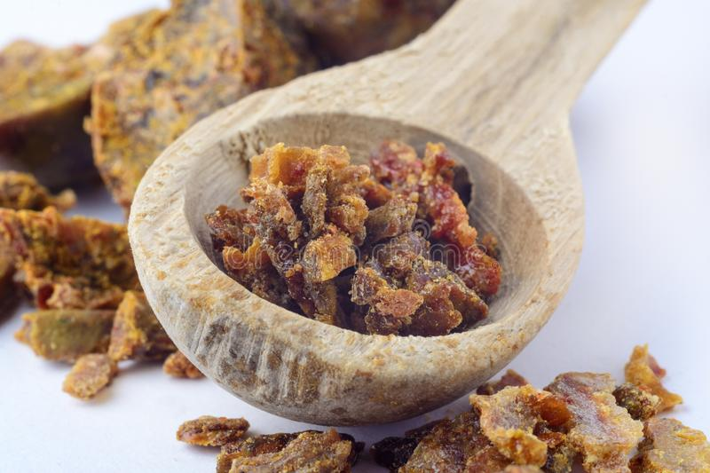 Propolis granules in a wooden spoon. Bee glue. Bee products. Apitherapy. Apiculture. Propolis granules in a wooden spoon. Bee glue. Bee products. Apitherapy stock photo