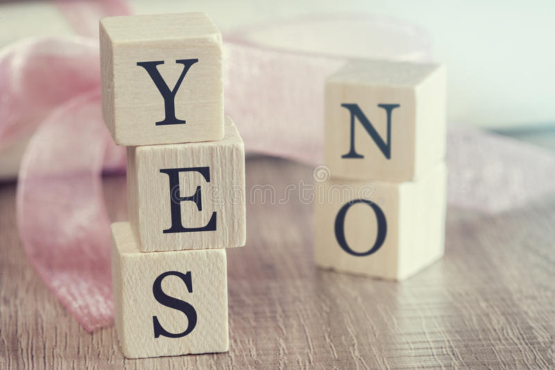Proposal concept. Wooden blocks forming Yes and No words royalty free stock photos